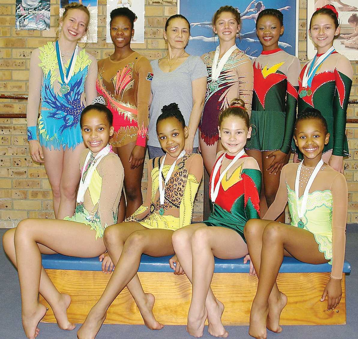 These rhythmic gymnasts excelled and achieved the following places, (back) Rozel Coetzee (Level 10, second place), Palesa Mohlamme (Senior Olympic, third place), Tatiana Lavrenchouk-Vizer (coach), Lilica Burger (Senior Olympic, first place), Hlompho Tlale (Level 4), Kara Muller-Van Schalkwyk (Level 4, first place and highest overall score), (front) Akira Stander (High Performance 1, first place), Lebo Maake (High Performance 2, first place), Delrike Maritz (Level 5) and Siyanda Tom (Level 8, second place). Jana Erasmus (Level 5, third place) and Candice Uys (Senior Olympic, second place) were absent.
