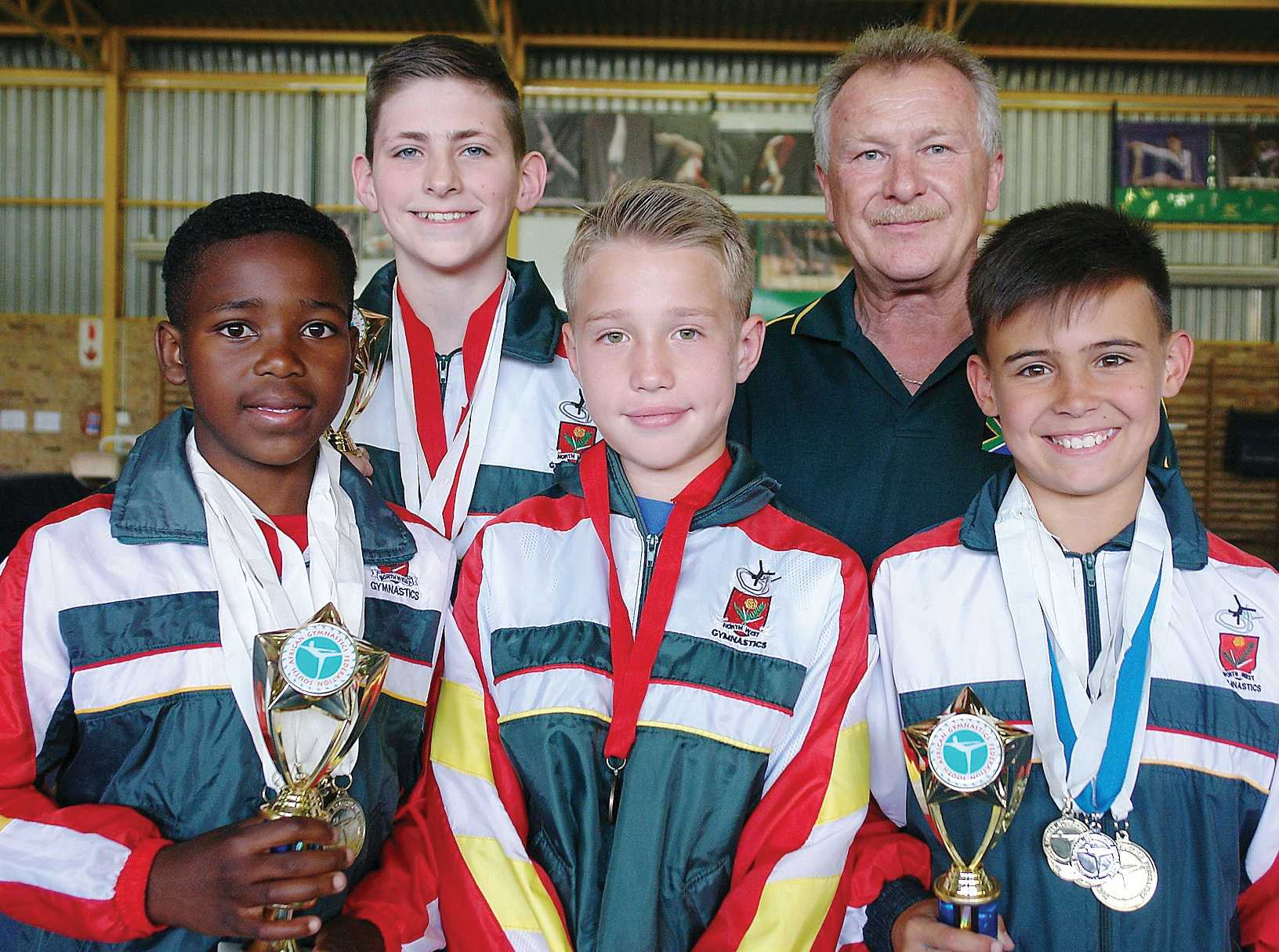 These boys, trained by Oleg Vizer (back, right), shined at the recent National Gym Games in Pretoria. In the front row are Bhula Ngcengeni (Level 7, first place overall, highest overall score, gold medals for all six apparatus), Ruben De Klerk (Class 1, High performance, fifth place overall, one bronze medal), Stephan Pelser (Level 5, first place overall, highest overall score, four gold medals and one silver) and back Keanan De Vries (Level 6, first place overall, highest overall score, one gold and one bronze medal).