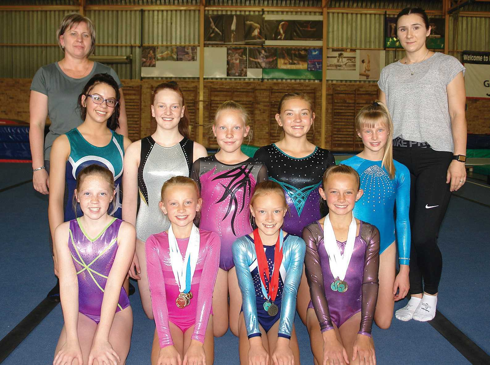 These artistic gymnasts from KSG proved themselves at the National Gym Games in Pretoria - (front) Chané Scholtz (Level 4), Ria Schulenburg (Level 4, first place overall, three gold and one silver medal), Zanté Lemmer (Level 5, third place overall, one silver and one bronze medal), Carmin Schulenburg (Level 6, first place overall and three gold medals), (back) Christelie Jansen Van Vuuren (Level 6), Enrica Buys (Level 5), Keandra Jooste (Level 4), Thelanné Joubert (Level 4) and Mia Visser (Level 6). With them are their proud coaches Suzette de Villiers and Yana Vizer-Graceffa.