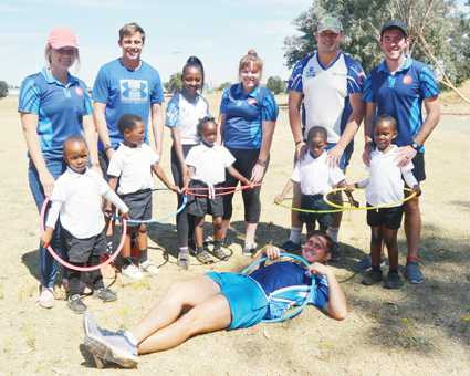 The Sports Management students of Centurion Academy are seen with little ones from Madikwe and their hoola hoops. The students are Natasha Willemse, Adrian Roestoff, Fifi Mosweu, Hanje Nel, Christiaan van Zyl, Jundrey Britz and Ronin Ludick.