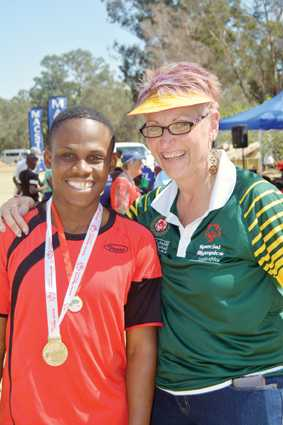 All competitors received medals for participation. Marlene Schutte, North West Provincial Coordinator, handed Itumeleng Sebekedi of Orkney his medals. He attends Ikalafeng in Potchefstroom.