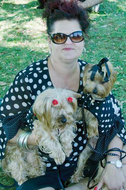 Elize Kruger and Yorkies, Pixie and Bella, are dressed up in polkadots.